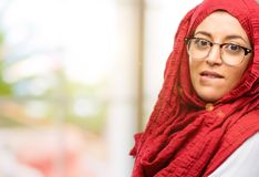 Young arabian woman wearing hijab isolated over natural background. Young arab woman wearing hijab nervous and scared biting lips looking camera with impatient Stock Image