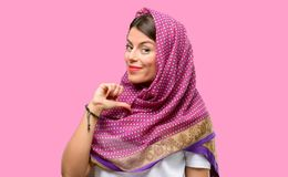 Young arab woman. Wearing hijab proud, excited and arrogant, pointing with victory face Royalty Free Stock Image