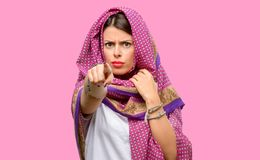 Young arab woman. Wearing hijab pointing to the front with finger Royalty Free Stock Images