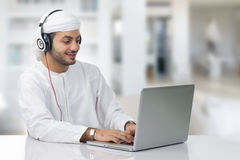 Young Arabian businessman working on his notebook Royalty Free Stock Photos
