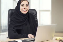 Young Arabian Businesswoman working in the office.  Royalty Free Stock Image