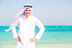 Young Arabian Man On The Beach Royalty Free Stock Photos