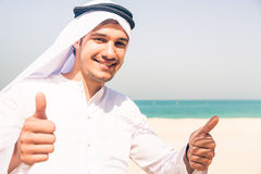 Young Arabian Man On The Beach Royalty Free Stock Images