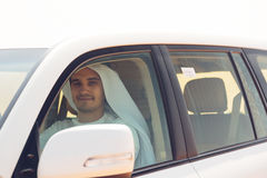 Young Arabian Man In The Desert. Driving his SUV Royalty Free Stock Image