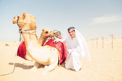 Young Arabian Man With His Camels Stock Image