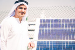 Young Arabian Man With Solar Panel Stock Images