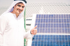 Young Arabian Man With Solar Panel Royalty Free Stock Photo