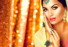 Young arabian woman with mehndi tattoo and perfect make-up Royalty Free Stock Images
