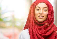 Young arabian woman wearing hijab isolated over natural background. Young arab woman wearing hijab raising his finger, the number one Royalty Free Stock Photography