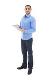 Young arabic bearded man writing something on clipboard isolated Royalty Free Stock Image