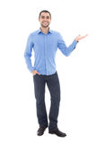 Young arabic business man in blue shirt pointing at something is. Olated on white background Stock Photo