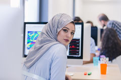 Young Arabic business woman wearing hijab,working in her startup. Office Royalty Free Stock Images