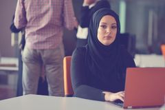 Young Arabic business woman wearing hijab,working in her startup office. Diversity, multiracial concept.  Stock Photo