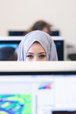 Young Arabic business woman wearing hijab,working in her startup. Office. Diversity, multiracial concept Royalty Free Stock Photography