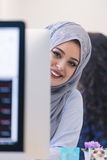 Young Arabic business woman wearing hijab,working in her startup. Office. Diversity, multiracial concept Stock Image
