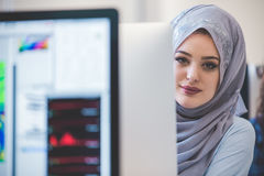 Young Arabic business woman wearing hijab,working in her startup. Office. Diversity, multiracial concept Stock Photos