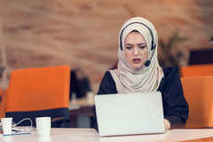 Young Arabic business woman wearing hijab,working in her startup office. Diversity, multiracial concept Stock Image