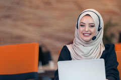 Young Arabic business woman wearing hijab,working in her startup office. Diversity, multiracial concept Royalty Free Stock Images