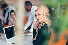 Young Arabic business woman wearing hijab,working in her startup office. Young Arabic business women wearing hijab,working in her startup office Stock Photography
