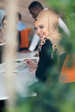 Young Arabic business woman wearing hijab,working in her startup office. Young Arabic business women wearing hijab,working in her startup office Royalty Free Stock Photos