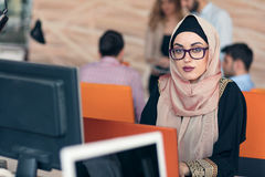 Young Arabic business woman wearing hijab,working in her startup office. Young Arabic business women wearing hijab,working in her startup office Royalty Free Stock Photography