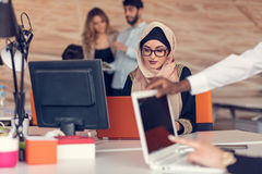 Young Arabic business woman wearing hijab,working in her startup office. Young Arabic business women wearing hijab,working in her startup office Stock Photos