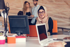 Young Arabic business woman wearing hijab,working in her startup office. Young Arabic business women wearing hijab,working in her startup office Royalty Free Stock Photo