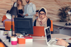 Young Arabic business woman wearing hijab,working in her startup office. Young Arabic business women wearing hijab,working in her startup office Stock Images