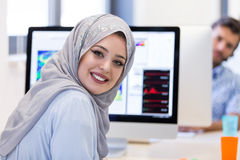Young Arabic business woman wearing hijab,working in her startup. Young Arabic business women wearing hijab,working in her startup office Stock Photo