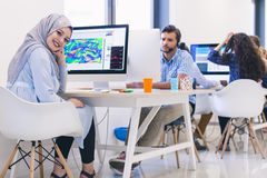 Young Arabic business woman wearing hijab,working in her startup Stock Photo