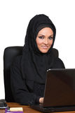 Young Arabic business woman, working in office. Young Arabic business woman, working in her office Stock Photo