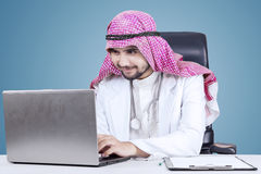 Young Arabic doctor uses laptop Stock Image