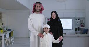 Muslim family with kid in modern home