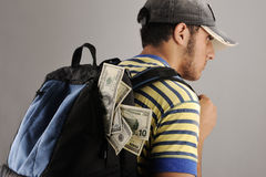Young arabic man with backpack with money stock images