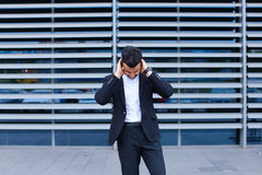 Young arabic man shows neck pain tired in business center Stock Photography