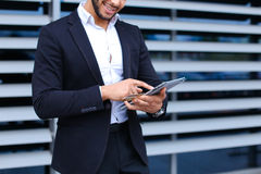 Young arabic man uses tablet  online order shopping in business Stock Photo