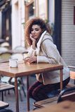 Arab girl in casual clothes drinking a soda outdoors. royalty free stock photo