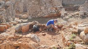 Young archeologist works on an archaeological site. In the ancient city stock footage
