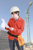 Young architect. In safety helmet  in front of construction site Stock Photography