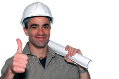 Young architect. With an architectural plans showing his thumbs up Royalty Free Stock Image