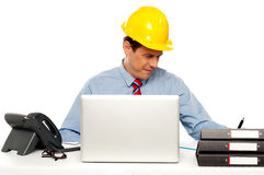 Young architect actively working at his desk Stock Images