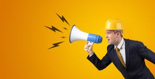Young architect yelling with megaphone royalty free stock image