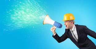Young architect yelling with megaphone royalty free stock photography