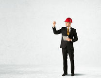 Young architect drawing in empty space Stock Photo