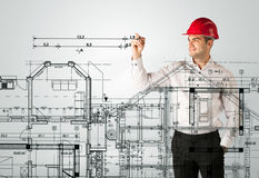 An young architect drawing a house plan Royalty Free Stock Photo