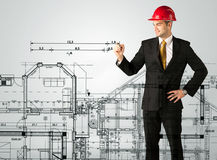 An young architect drawing a house plan Stock Photos