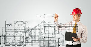An young architect drawing a house plan Royalty Free Stock Images