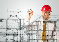 An young architect drawing a house plan Stock Images