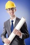 Young architect with drawings Royalty Free Stock Photo