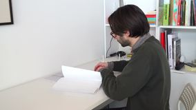 Young architect-engineer checks the construction drawings